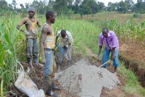 The Water Project: Makunga Community, Tabarachi Spring -  Community Members Mixing Cement