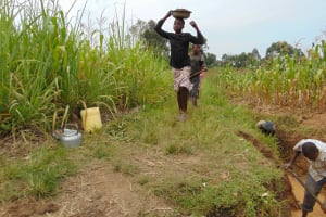 The Water Project: Makunga Community, Tabarachi Spring -  Locals Bringing Materials