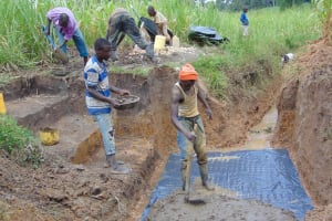 The Water Project: Makunga Community, Tabarachi Spring -  Community Members Assist