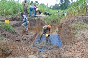 The Water Project: Makunga Community, Tabarachi Spring -  Slab Setting