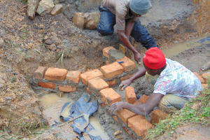 The Water Project: Makunga Community, Tabarachi Spring -  Building Walls