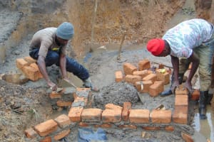 The Water Project: Makunga Community, Tabarachi Spring -  Wall Construction