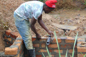 The Water Project: Makunga Community, Tabarachi Spring -  Pipe Installation