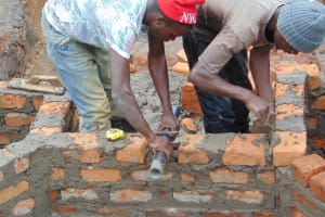 The Water Project: Makunga Community, Tabarachi Spring -  Pipe Setting