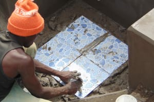 The Water Project: Makunga Community, Tabarachi Spring -  Tile Setting
