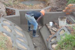 The Water Project: Makunga Community, Tabarachi Spring -  Plastering