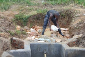 The Water Project: Makunga Community, Tabarachi Spring -  Backfilling Stone