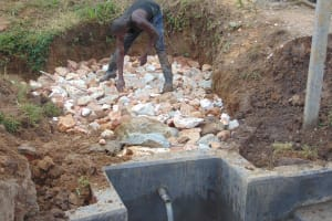 The Water Project: Makunga Community, Tabarachi Spring -  Backfilling Rocks