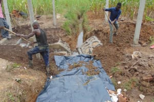 The Water Project: Makunga Community, Tabarachi Spring -  Adding Soil
