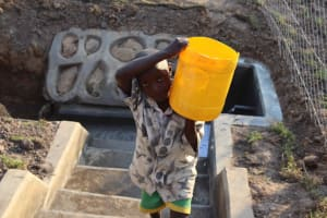 The Water Project: Makunga Community, Tabarachi Spring -  Brian Carrying Water