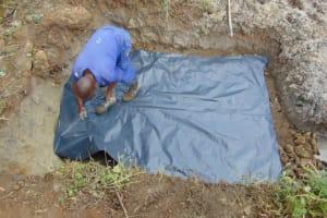 The Water Project: Malimali Community, Onyango Spring -  Slab Setting