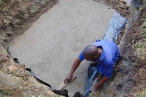 The Water Project: Malimali Community, Onyango Spring -  Smoothing The Slab