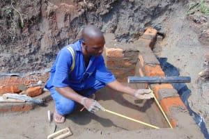 The Water Project: Malimali Community, Onyango Spring -  Pipe Setting
