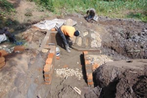 The Water Project: Malimali Community, Onyango Spring -  Pitching Stones