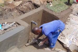 The Water Project: Malimali Community, Onyango Spring -  Plastering