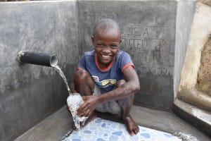 The Water Project: Malimali Community, Onyango Spring -  Omondi Filling A Glass