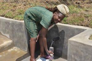 The Water Project: Malimali Community, Onyango Spring -  Gladys Fetching Water