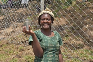 The Water Project: Malimali Community, Onyango Spring -  Gladys With Water