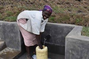 The Water Project: Malimali Community, Onyango Spring -  Robai Fetching Water