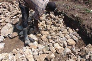 The Water Project: Namushiya Primary School -  Spreading Stone