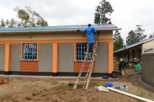 The Water Project: Namushiya Primary School -  Placing Gutters