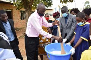 The Water Project: Namushiya Primary School -  Principal Mixing Soap