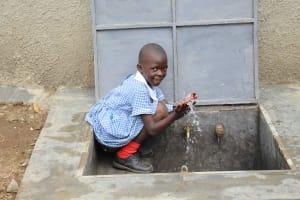 The Water Project: St. Elizabeth Shipala Primary School -  Splashing Girl