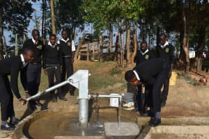 The Water Project: Shamberere Boys' High School -  Students Collecting Water