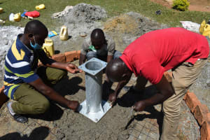The Water Project: Bukhakunga Primary School -  Pump Stand Fixing