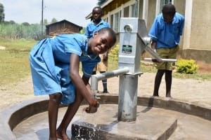 The Water Project: Bukhakunga Primary School -  Collecting Water At The Borehole