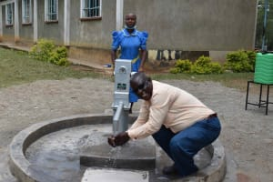 The Water Project: Bukhakunga Primary School -  Mr John Chiliswa The School Head Teacher At The Water Point