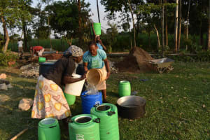 The Water Project: Bukhakunga Primary School -  Parents Bringing Water