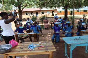 The Water Project: Bukhakunga Primary School -  Proper Mask Wearing Demonstration