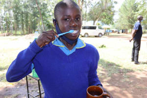 The Water Project: Bukhakunga Primary School -  Student Practices Brushing