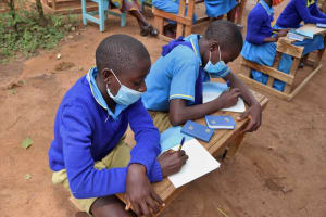 The Water Project: Bukhakunga Primary School -  Students Take Notes At The Training