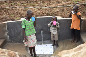 The Water Project: Khunyiri Community, Edward Spring -  Quenching Thirst