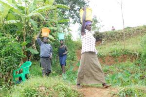 The Water Project: Khunyiri Community, Edward Spring -  Bringing Materials
