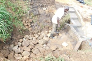 The Water Project: Khunyiri Community, Edward Spring -  Layer Of Stone