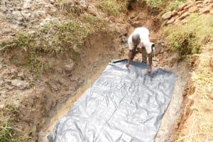 The Water Project: Khunyiri Community, Edward Spring -  Laying Foundation