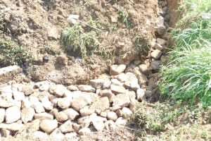 The Water Project: Khunyiri Community, Edward Spring -  Laying Stone