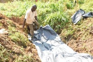 The Water Project: Khunyiri Community, Edward Spring -  Laying Tarp