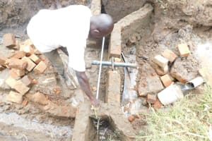 The Water Project: Khunyiri Community, Edward Spring -  Pipe Measuring