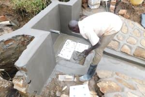 The Water Project: Khunyiri Community, Edward Spring -  Placing Tiles