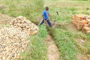 The Water Project: Khunyiri Community, Edward Spring -  Runoff Channel Construction