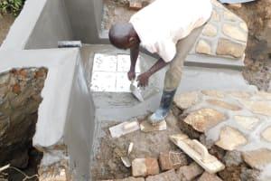 The Water Project: Khunyiri Community, Edward Spring -  Tile Placing