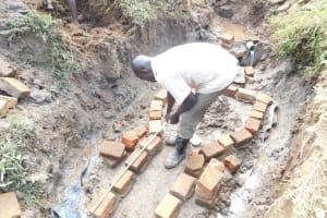 The Water Project: Khunyiri Community, Edward Spring -  Wall Measuring