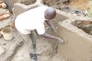 The Water Project: Khunyiri Community, Edward Spring -  Wall Plastering