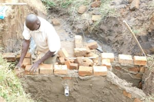 The Water Project: Khunyiri Community, Edward Spring -  Walls Being Built