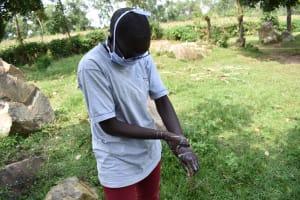 The Water Project: Khunyiri Community, Edward Spring -  Bilha Washing Hands