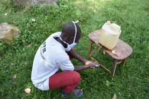 The Water Project: Khunyiri Community, Edward Spring -  Leaky Tin Use
